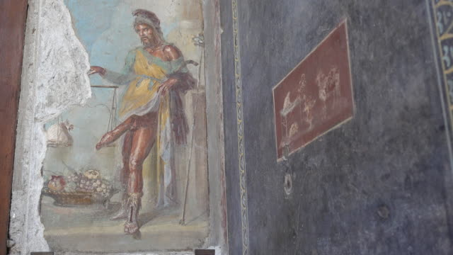 wall fresco artwork painting of a man with a large penis in the ancient ruins of pompeii, italy, europe. - pornography stock videos & royalty-free footage
