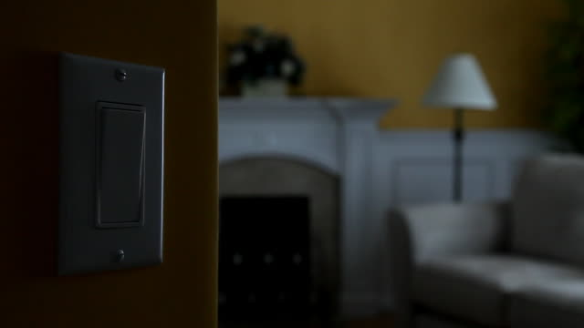 wall light switch - turning on or off stock videos & royalty-free footage
