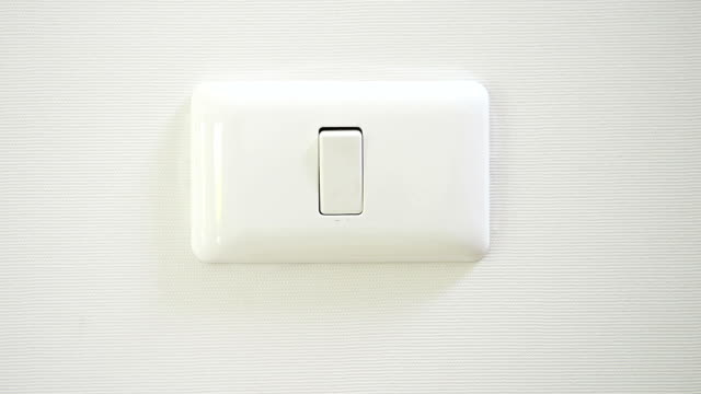 Switch plate videos and b roll footage getty images hd wall light switch aloadofball Choice Image