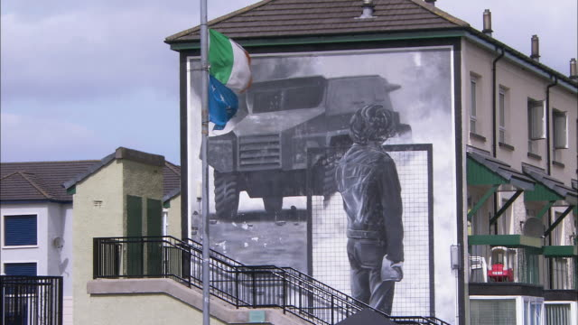 Wall mural, statue and Irish flag, Derry, Northern Ireland