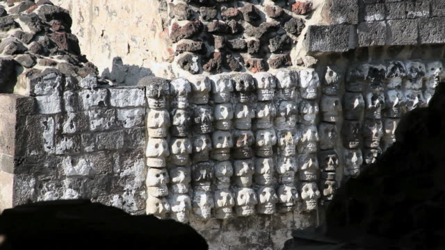 CU Wall of ancient temple with carved skulls/ Mexico City, Mexico, Mexico