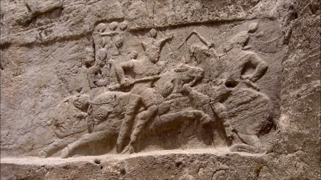 MS ZI Wall of ancient tomb with bas relief depicting warriors, Near Persepolis, Iran