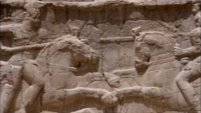 CU PAN Wall of ancient tomb with bas relief depicting warriors, Near Persepolis, Iran