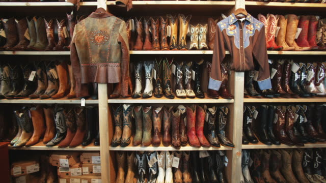 wall of cowboy boots at a western wear store