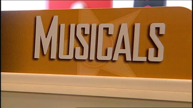 wall of musicals vhs tapes at blockbuster - エディトリアル点の映像素材/bロール