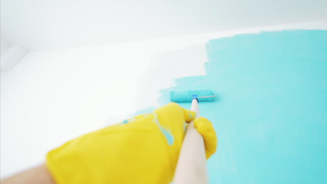 pov wall painting with paint roller. - painting stock videos & royalty-free footage