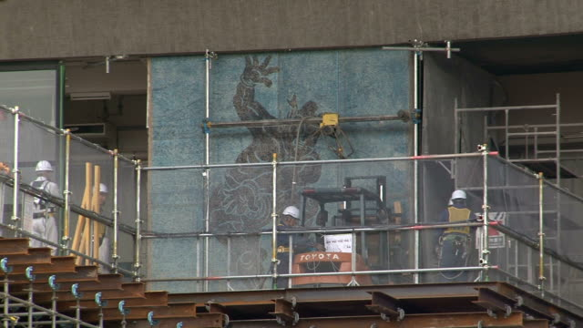 wall picture depicting legendary sumo wrestler was removed at tokyo's national stadium on wednesday november 5 for its reconstruction work for the... - darstellen stock-videos und b-roll-filmmaterial