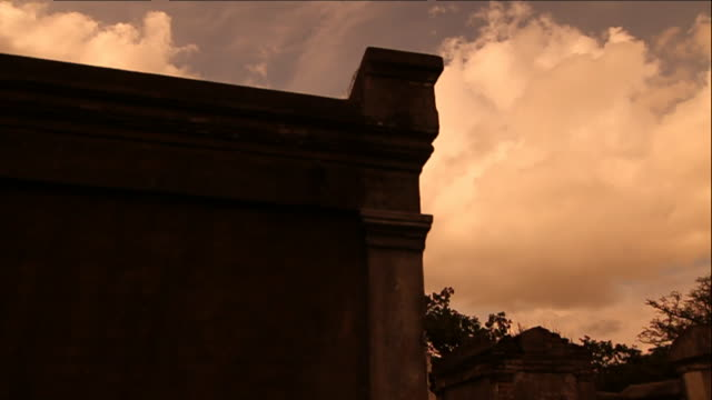 wall & roof of tomb, gray clouds in sky, revealing weather-beaten vaults, pathway. funeral, death, graveyard, grave, burial, mourning. - cemetery stock videos & royalty-free footage
