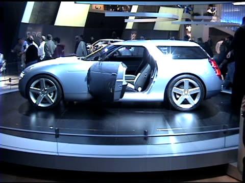 wall sign / driver side view of chevy nomad concept revolving on turntable / dashboard; speedometer resembles '55-'57 chevys / rear end of car /... - insignier bildbanksvideor och videomaterial från bakom kulisserna