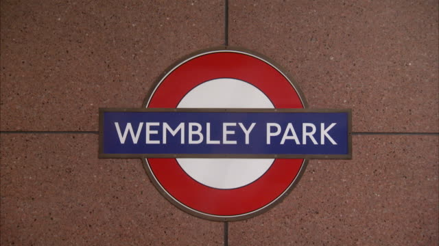 A wall sign identifies Wembley Park station stop on the London underground. Available in HD.