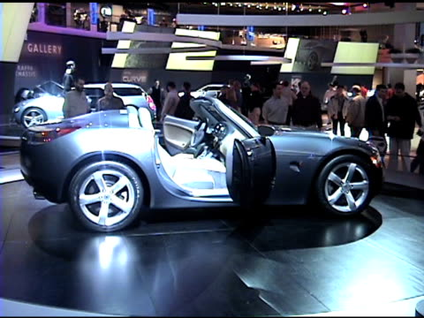 ws wall sign pan right to pontiac solstice revolving on turntable / mws front end of car / ws passenger side front end and driver side profile of car... - pontiac stock videos and b-roll footage