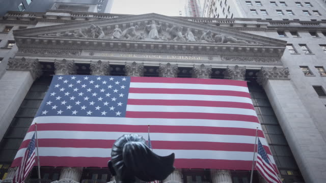 wall street: new york stock exchange . american us flags on the outside of the stock exchange. daytime. filmed during the reopening phase of the... - bull market stock videos & royalty-free footage