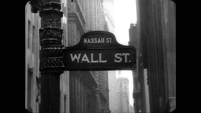 stockvideo's en b-roll-footage met wall street sign corner of nassau st wall street sign on march 10 1937 in new york new york - 1937