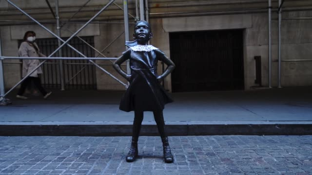 """wall street's """"fearless girl"""" statue wears a lace collar in memory of the late supreme court justice ruth bader ginsburg, in new york, united states,... - lace textile stock videos & royalty-free footage"""