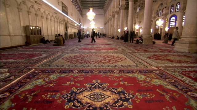 Wall to wall rugs line the great halls of the Umayyad Mosque Damascus. Available in HD.