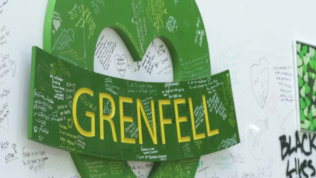 wall where messages of support have been written, surrounding grenfell tower in west london on june 14 on the third anniversary of the high-rise fire... - surrounding wall点の映像素材/bロール