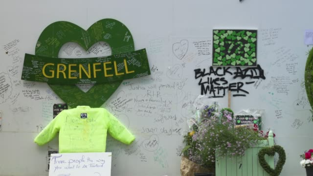 wall where messages of support have been written, surrounding grenfell tower in west london on june 14 on the third anniversary of the high-rise fire... - domestic kitchen stock videos & royalty-free footage