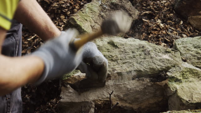 Waller Breaking Up Stone with Hammer and Chisel