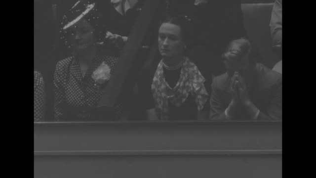 vs wallis simpson and the duke of windsor in gallery she appears to listen he plays with his nose they applaud / they exit capitol he puts on hat... - wallis simpson stock videos & royalty-free footage