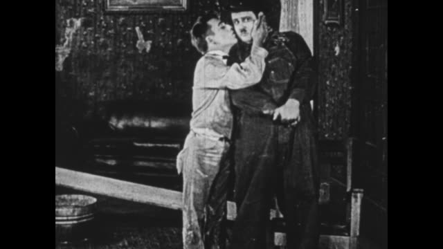 1925 wallpaper manager (oliver hardy) and his assistant give each other a kiss before hugging - 1925 stock videos & royalty-free footage