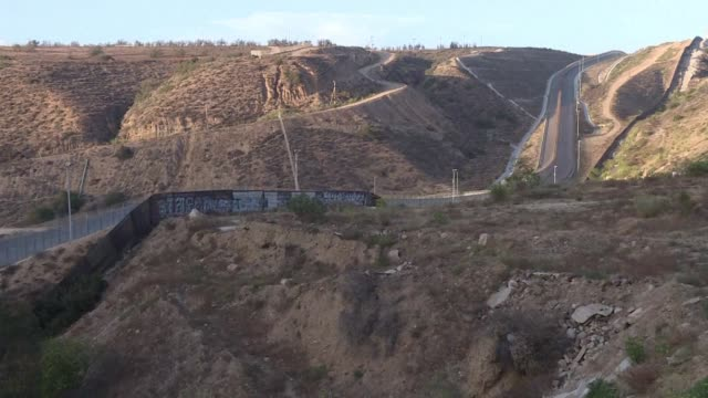 Walls barbed wire or other barriers currently divide Mexico and the United States along onethird of their 3145 kilometer border
