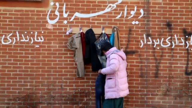 walls of kindness where iranian people donate clothing for those in need during the winter are seen in the streets of tehran iran on january 11 2016... - mashhad stock videos & royalty-free footage