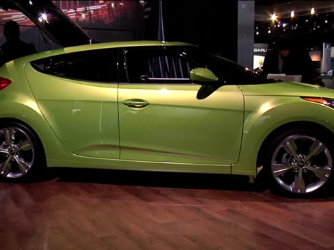 WS wallsized Veloster sign / WS front quarter passenger side view of Electrolyte Green Veloster / WS passenger side profile assymetrical two doors...