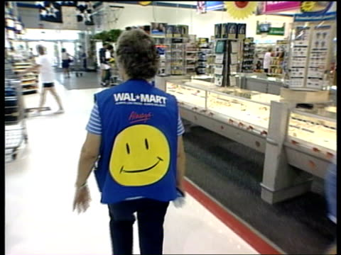 stockvideo's en b-roll-footage met channel 4 news special report walmart channel 4 news special report ext ms shoppers towards past from store pushing trolley gv walmart superstore... - wal mart