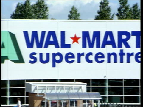 stockvideo's en b-roll-footage met bristol ext/itn ws cars into parking area of asda walmart store/ gvs wal mart supercentre/ shoppers loading car with shopping gvs shoppers inside... - wal mart