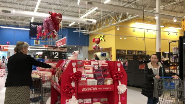 walmart super shopping center in north georgia. walmart inc. is an american multinational retail corporation that operates a chain of hypermarkets,... - バレンタインデー点の映像素材/bロール
