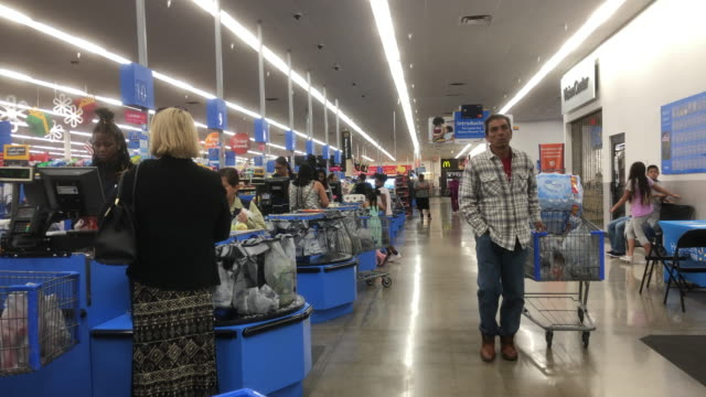 walmart super shopping center is an american multinational retail corporation that operates a chain of hypermarkets, discount department stores, and... - chain store stock videos & royalty-free footage