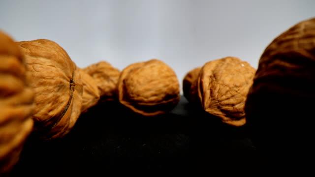 walnuts in super macro - nutshell stock videos & royalty-free footage