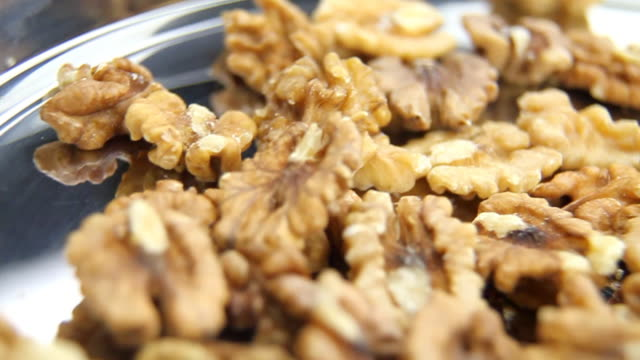 walnuts on metal plate - loopable, hd - walnut stock videos & royalty-free footage