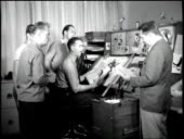 Walt disney approches a group of his animators with insignia drawings video id508764717?s=170x170