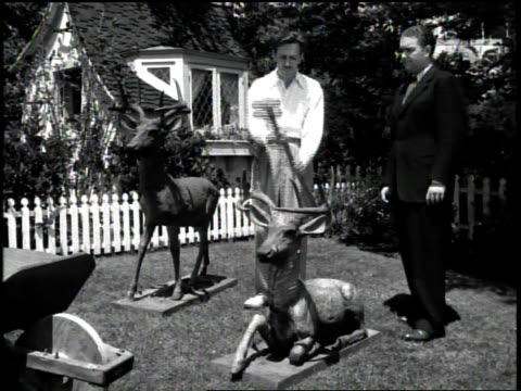 walt disney donates two iron deer statues for scrap metal / man uses a sledgehammer on one / - disney stock videos and b-roll footage