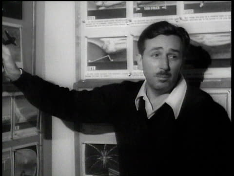 walt disney explaining drawings and smiling / hollywood california united states - disney stock videos and b-roll footage