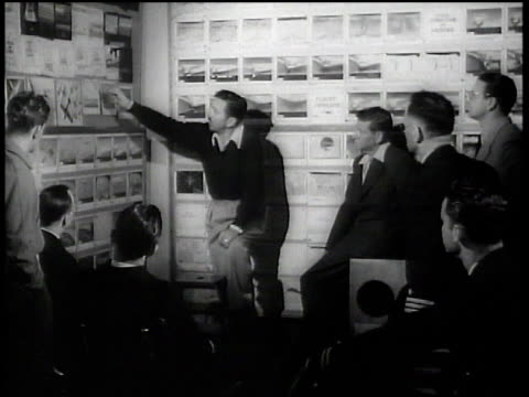 walt disney explaining drawings to naval officers / hollywood california united states - disney stock videos and b-roll footage