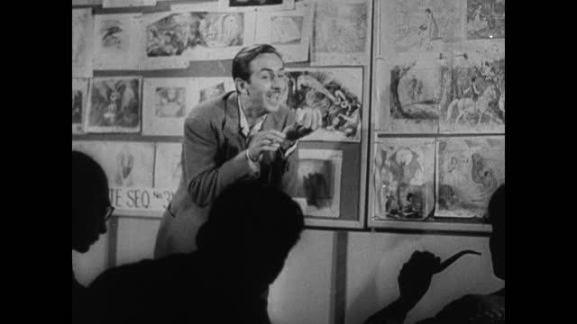 walt disney parking lot entrance, walt disney studios sign, walt disney working with his animators. - disney stock videos & royalty-free footage