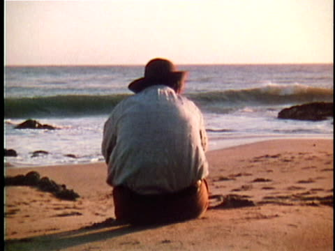 1971 REENACTMENT MS Walt Whitman sitting on beach with back to camera / 19th Century United States / AUDIO