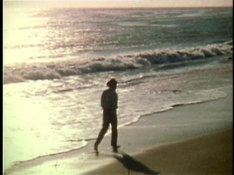 1971 REENACTMENT WS Walt Whitman walking along beach with sun relflecting on ocean / 19th Century United States / AUDIO