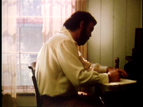 1971 REENACTMENT MS Walt Whitman writing at desk in bedroom / 19th Century United States / AUDIO