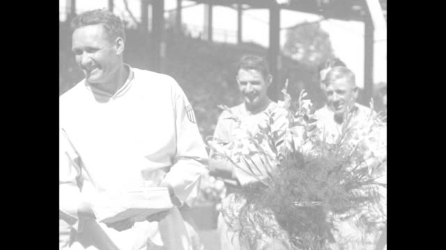 MS Walter Johnson pitcher for the Washington Senators on the field with teammates at Griffith Stadium two big flower arrangements nearby / MS Johnson...