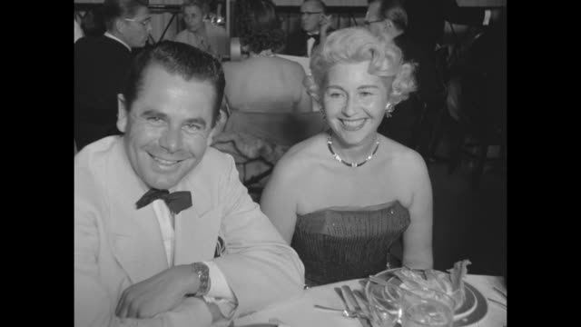 walter pidgeon with greer garson / robert stack with ruth pidgeon / glenn ford with sheila graham / peixotoís assistant osman moreno with cesar... - 20th century fox stock videos & royalty-free footage