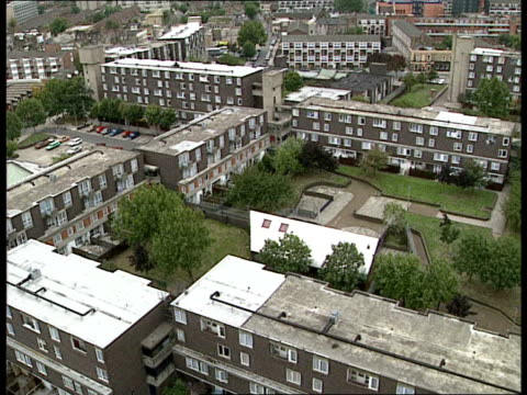tower blocks 19 gv of flats on the renway estate cu of builders working on new window frame gv of builder removing old window gv of garage area in... - fensterfront stock-videos und b-roll-filmmaterial