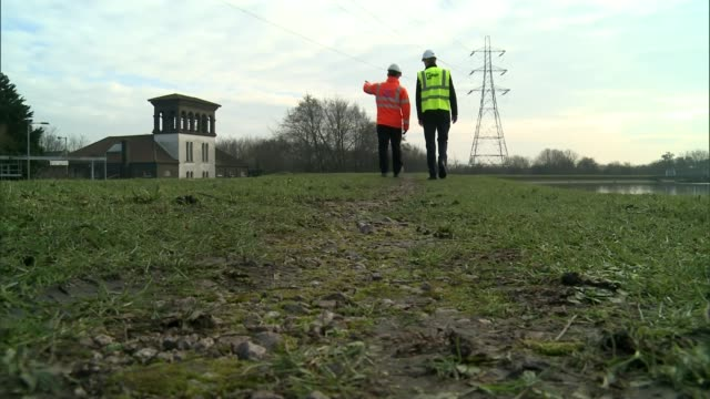 walthamstow wetlands to be europe's largest urban wetland walthamstow wetlands to be europe's largest urban wetland fisherman by lake wide shot... - water bird stock videos & royalty-free footage