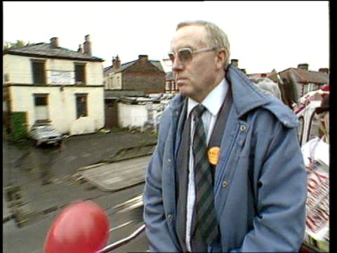 labour victory/militant itn lib liverpool broadgreen constituency ms then lab candidate terry fields stands in open top bus as along with red flag... - merseyside stock videos and b-roll footage