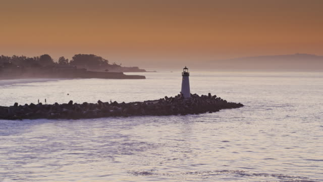walton lighthouse, santa cruz at sunrise - drone shot - santa cruz california stock videos and b-roll footage