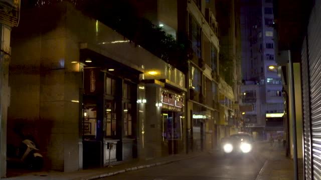 wan chai narrow street taxi at night - wan chai stock videos & royalty-free footage