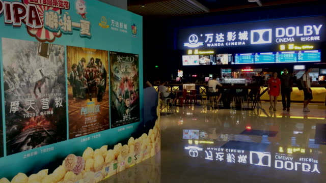 wanda cinema line is china's biggest movietheater operator - fahrkartenschalter stock-videos und b-roll-filmmaterial