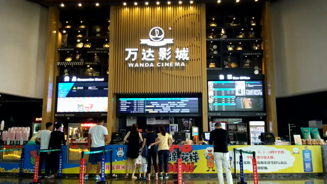 wanda group, china's largest commercial real estate group, has sold its business in cultural tourism and hotel assets recently. on jul. 25th, it is... - china film group stock videos & royalty-free footage
